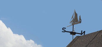Weather vane. Close-up of weather vane made in the form of a sailing vessel; picture has plenty of text space stock photos