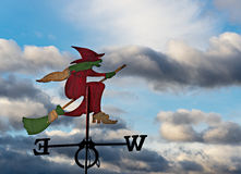Weather vane on cloudy sky Royalty Free Stock Images