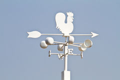 Weather vane - cockerel which reflected sun Stock Images