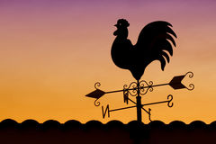 Weather Vane in Colorful Sky Stock Photography