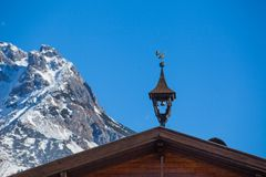 Weather vane in the form of a... Weather-vane in the form of a on the roof - Austria royalty free stock images