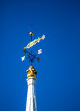 Weather vane highlited by sun Stock Photo