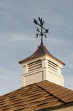Weather Vane. An image of a weather vane on top of a building stock images