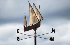 Weather vane. Metallic ship weather vane on sky background royalty free stock photography