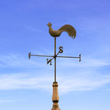 Weather Vane. An Old Rooster Weather Vane with Blue Sky stock photos