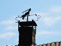 Weather vane on old smokestack. Weather vane - witch - on old house smokestack, Lithuania Royalty Free Stock Image