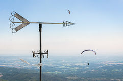 Weather vane. And paraglider hang gliding stock photos