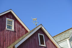 Weather vane on a roof Royalty Free Stock Image