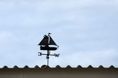 Weather vane on the roof. Against blue sky stock images