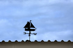 Weather vane on the roof Royalty Free Stock Photography