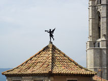 The weather vane. On the roof of the building. Girona, Spain royalty free stock photos