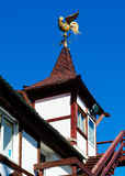 Weather vane on the roof of the tower. Royalty Free Stock Image