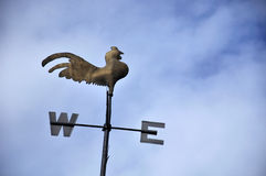 Weather vane rooster. A rooster weather vane against a clear blue sky royalty free stock image