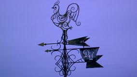 Weather vane with rooster. Against the evening sky stock footage