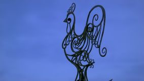 Weather vane with rooster. Against the evening sky stock video footage
