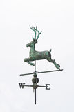 Weather vane shaped like a deer on a white background. Copper weather vane shaped like a deer isolated on a white background stock photos