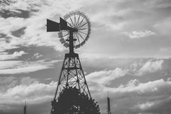 Weather vane. Is showing the direction of the wind, edited in black and white royalty free stock photos