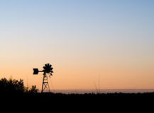 Weather Vane Silhouette. A weather vane silhouette against a sunset Royalty Free Stock Images