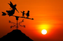 Weather vane at sunset Stock Photo