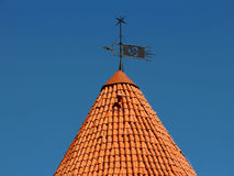 Weather vane and tower Royalty Free Stock Photo