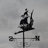 Weather Vane. View of an Antique Ship Themed Weather Vane Silhouetted against an Overcast Grey Sky Stock Images