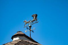 Weather Vane. A Weather Vane which has a horse and carriage stock photo