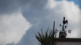 Weather Vane in Windy Conditions. With Fast Moving Clouds in the Background stock video footage