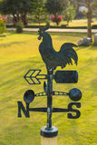 Weather vanes on grass in garden Royalty Free Stock Images