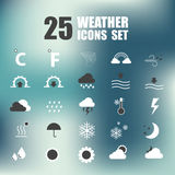 25 Weather Vector Icons on blurred background. Stock Photos