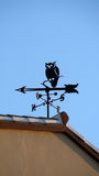 Weather Wane. On roof depicting an owl stock images