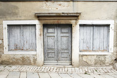 A Weatherbeaten Doorway And Shutters Stock Photo