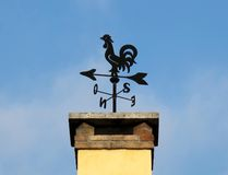 Weathercock. On a chimney-yellow Stock Image