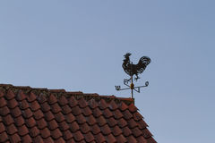 Weathercock on the roof Royalty Free Stock Photos