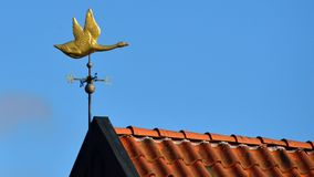 Weathercock on a roof Royalty Free Stock Photo