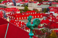 Weathercock on the roof, Czech, Prague, city view. Prague architecture, red roofs, weather vane shape of rooster. stock image