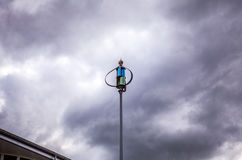 Weathercock of weather station against dramatical twilight sky Royalty Free Stock Photography