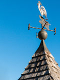 Weathercock, weather vane wind direction decoration. On a roof top royalty free stock image