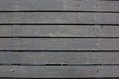 Weatherd wood lath line arrange pattern textrue background.Texture of dark untreated wood. Old wooden laths background, Weathered larch background. Wooden royalty free stock images