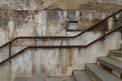Weathered and abandoned outdoor stairs with rusty railing Stock Photography