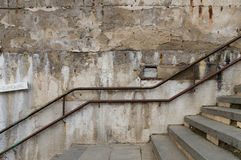 Weathered and abandoned outdoor stairs with rusty railing Stock Photos