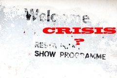 Weathered advertising sign and new text CRISIS Stock Images