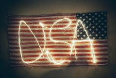 Weathered American flag with word USA written on Royalty Free Stock Photos