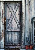 Weathered And Painted Wooden Door On The Wall Of A Beach Shack Stock Images