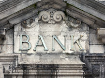 Weathered bank sign on building Stock Photo