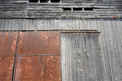 Weathered barn. Iron doors to an old weathered barn Royalty Free Stock Images