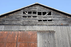 Weathered barn. Old weathered barn against a blue sky Stock Photos