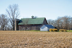 Weathered Barn with Green Roof Stock Photo