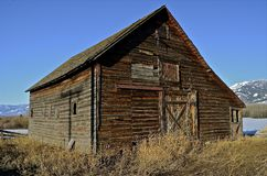 Weathered Barn in Mountainous Region Stock Photography