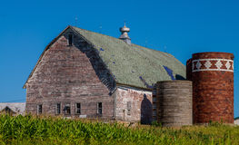 Weathered barn, silos, cornfield Stock Photo
