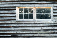 Weathered Barn Wall with Overlapped Wood Siding with Two Windows Royalty Free Stock Image
